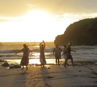 group sunset salutation